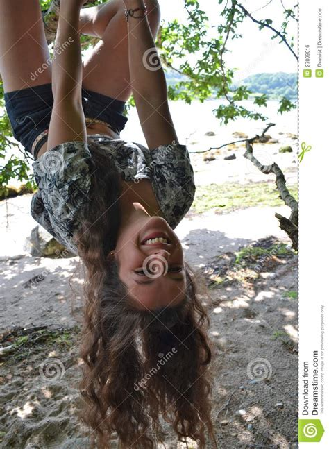 Teenage Girl Swinging From A Tree Royalty Free Stock Image